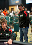 Team Pokerstars Pro and Italy Team Captain Luca Pagano checks on his player during heads up play.