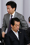June 28th, 2011, Tokyo, Japan - Jun Azumi, Diet Affairs Committee chairperson, walks behind Japanese Prime Minister Naoto Kan during a general membership meeting of the ruling Democratic Party of Japan at the Diet in Tokyo on Tuesday, June 28, 2011. Defining for the first time conditions for fulfilling his June 2 pledge to resign, Kan said on Monday he would resign after the passage of three key bills - the second reconstruction budget, the renewable energy bill and the bond-issuance bill. Kan has been under pressure from both the opposition and his own Democratic Party of Japan to step down over his poor handling of the March 11 earthquake and tsunami that caused the biggest nuclear catastrophe in 25 years. (Photo by AFLO) [3609] -mis-...