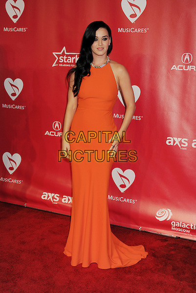 Katy Perry.At the 2013 MusiCares Person Of The Year at Los Angeles Convention Center in Los Angeles, California, USA,.8th February 2013..full length orange dress silver neckline sleeveless .CAP/ROT/TM.©Tony Michaels/Roth Stock/Capital Pictures