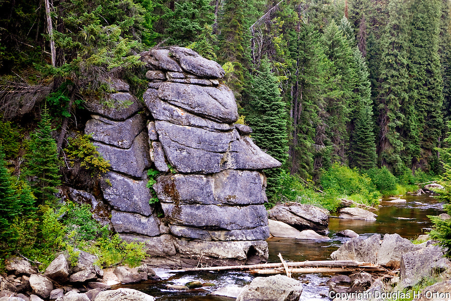 The remote Red River, a truly wild and scenic river in Idaho is an upper tributary of the Clearwater, a famous and remote trout stream.  Both are famous gold mining areas near Elk City, Idaho.  This natural stone sculpture faces downstream.