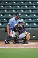 Winston-Salem Dash catcher Brett Austin (7) reaches for a pitch as home plate umpire Brock Ballou looks on during the game against the Wilmington Blue Rocks at BB&T Ballpark on June 5, 2016 in Winston-Salem, North Carolina.  The Dash defeated the Blue Rocks 4-0.  (Brian Westerholt/Four Seam Images)