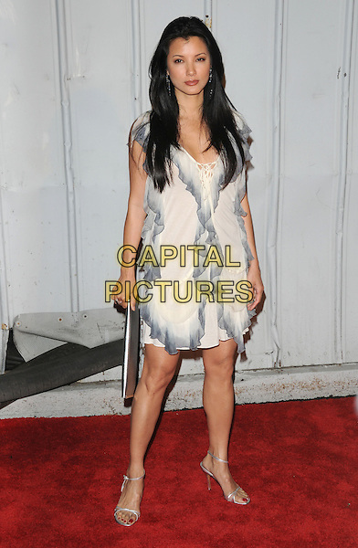 KELLY HU.The Maxim's Hot 100 List Party held at Barker Hangar in Santa Monica, California on .May 13th, 2009.full length white cream black grey gray ruffled ruffles dress silver clutch bag .CAP/DVS.©Debbie VanStory/Capital Pictures.