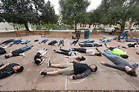 """Occidental College students participate in a """"Die-In"""" peaceful protest for victims of police brutality after the campus-wide teach-in on the Ferguson case and American society's response to the death of Michael Brown. Academic Quad, Friday, Dec. 5, 2014. (Photo by Marc Campos, Occidental College Photographer)"""