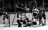 California Golden Seals vs Pittsburg Penguins 1970 Play-Off game. Seals Carol Vadnais trying to score..Penguins Dunc McCallum, goalie Les Binkley.<br />(photo/Ron Riesterer)