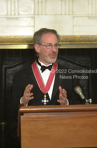"Film director Steven Spielberg thanks The British Ambassador, Sir Christopher Meyer KCMG, after receiving an Honorary Knighthood at a ceremony at the British Embassy in Washington, DC on January 29, 2001.  In his remarks the Ambassador said ""The award of an Honorary Knighthood to Steven Allan Spielberg is in recognition of his unique and outstanding contribution to international film, and in particular his services to the entertainment industry of the United Kingdom"".  He concluded by saying "" Mr. Spielberg epitomises the cultural partnership between our two countries.  I am privileged to present this historic award tonight on behalf of Her Majesty the Queen""..Credit: Ron Sachs / Pool via CNP"