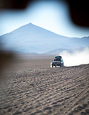BOLIVIA, Atacama Desert,Toyota Land Cruiser driving on dirtroads through the desert of the bolivian side of Atacama
