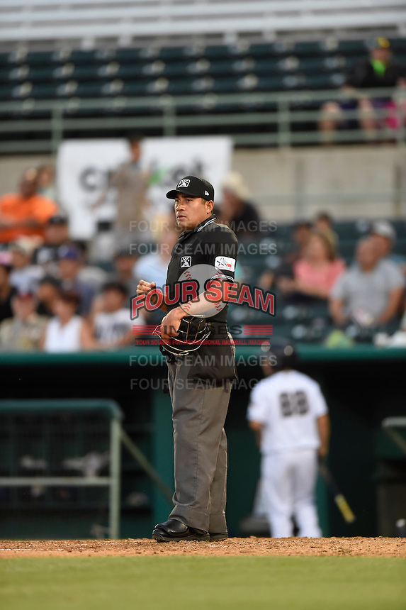 ***Temporary Unedited Reference File***Umpire Nestor Ceja during a game between the Midland RockHounds and San Antonio Missions on April 21, 2016 at Nelson W. Wolff Municipal Stadium in San Antonio, Texas.  Midland defeated San Antonio 9-2.  (Mike Janes/Four Seam Images)