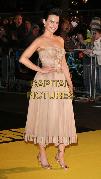 "CARLA GUGINO.The world premiere of ""Watchmen"" Odeon Leicester Square, London, England..February 23rd, 2009.full length beige dress strapless clutch bag gold hand on hip.CAP/ROS.©Steve Ross/Capital Pictures."