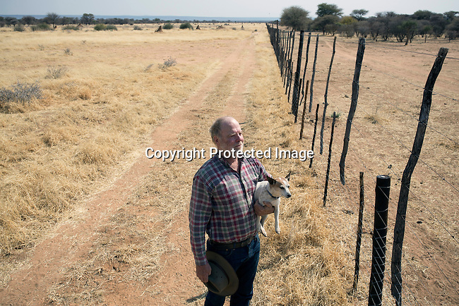 OTJIWARONGO, NAMBIA- AUGUST 14: German farmer W.G. Diekmann stands on the border of his land, at his massive 20,000 hectares farm named Hamakari outside Otjiwarongo, Namibia, about 280 km from Windhoek, Namibia.  His forefathers started running the farm in 1908. Hamakiri was the venue for a decisive battle on the Herero uprising in 1904. (Photo by Per-Anders Pettersson)