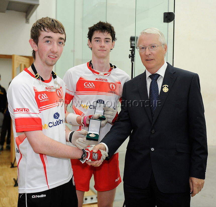 27th September 2014; <br /> Johnny Woods and Ryan Mullan of Tyrone are presented with their medals by GAA Handball President Willie Roche.<br /> M Donnelly 60x30 Championship 2014 Minor Doubles Final, Tipperary (Daniel Hayes/Jonathon Walsh) v Tyrone (Johnny Woods/Ryan Mullan)<br /> Picture credit: Tommy Grealy/actionshots.ie