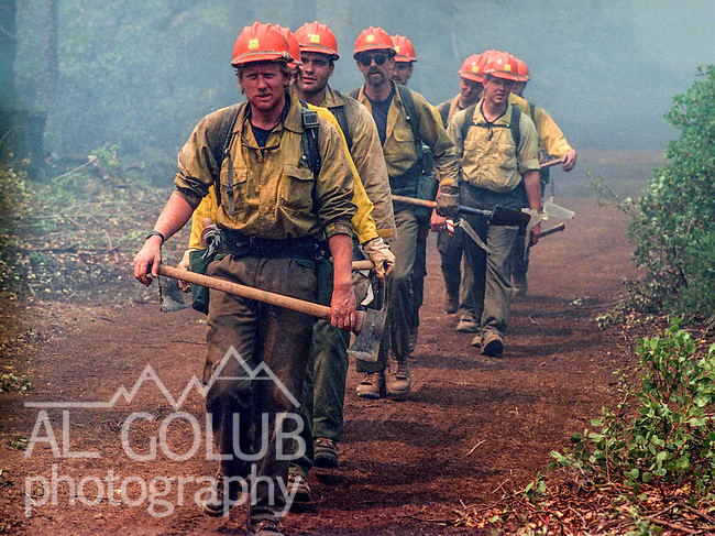 August 15, 1990 Yosemite National Park  --  A-Rock (Arch Rock) Fire  -- Mendocino Hotshot Matt Hogard leads crew down the firebreak.  The Arch Rock Fire burned over 16,000 acres of Yosemite National Park and the Stanislaus National Forest.  At the same time across the Merced River, the Steamboat Fire burned over 5,000 acres of both Yosemite National Park and the Sierra National Forest.