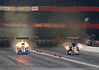 Jun 20, 2015; Bristol, TN, USA; NHRA top fuel driver Pat Dakin (left) explodes an engine alongside Steve Torrence during qualifying for the Thunder Valley Nationals at Bristol Dragway. Mandatory Credit: Mark J. Rebilas-USA TODAY Sports