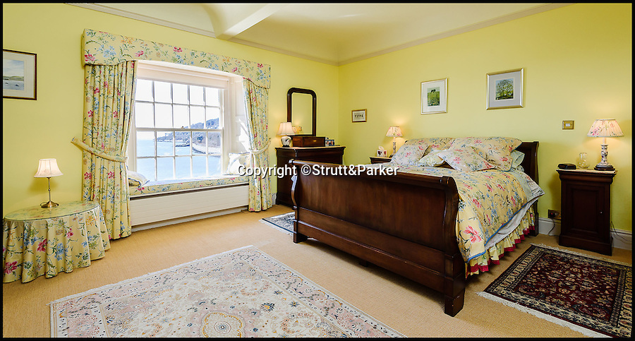 BNPS.co.uk (01202 558833)<br /> Pic: Strutt&Parker/BNPS<br /> <br /> Bedroom 2<br /> <br /> Go West...ultimate coastal hideaway with its own private island.<br /> <br /> A beautiful family home with its own private island is the perfect purchase for anyone with a sense of adventure.<br /> <br /> Trefri Hall is a stunning Grade II listed house with the Snowdonian hills as a backdrop and incredible views over the Dovey Estuary in mid Wales.<br /> <br /> But the real selling point is the small rocky island you can reach by bridge with your own castellated folly - ideal for pirate games or a spot of hide and seek.<br /> <br /> The house is up for sale with Strutt & Parker for £1.75million.