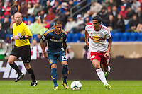 Tim Cahill (17) of the New York Red Bulls is marked by Rafael Garcia (25) of the Los Angeles Galaxy. The New York Red Bulls defeated the Los Angeles Galaxy 1-0 during a Major League Soccer (MLS) match at Red Bull Arena in Harrison, NJ, on May 19, 2013.