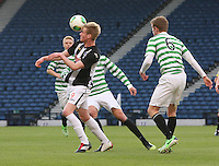 Blair Henderson heads the ball watched by Stuart Findlay in the Dunfermline Athletic v Celtic Scottish Football Association Youth Cup Final match played at Hampden Park, Glasgow on 1.5.13. ..