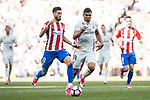 Yannick Ferreira Carrasco (l) of Atletico de Madrid battles for the ball with Carlos Henrique Casemiro of Real Madrid during their La Liga match between Real Madrid and Atletico de Madrid at the Santiago Bernabeu Stadium on 08 April 2017 in Madrid, Spain. Photo by Diego Gonzalez Souto / Power Sport Images