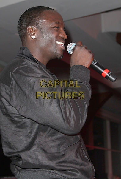 "AKON (Aliaune Thiam).""The Ultimate Prom"" 2009 Live Performance held at New York City's Chelsea Piers, New York, NY, USA..June 5th, 2009.half length stage concert live gig performance music black jacket microphone singing profile .CAP/ADM/PZ.©Paul Zimmerman/AdMedia/Capital Pictures."