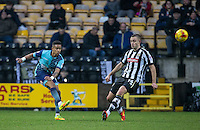 Paris Cowan-Hall of Wycombe Wanderers clears the ball past Louis Laing of Notts Co during the Sky Bet League 2 match between Notts County and Wycombe Wanderers at Meadow Lane, Nottingham, England on 10 December 2016. Photo by Andy Rowland.