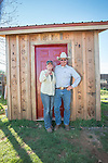 Colett Busi with her father Elliot Joses.<br /> <br /> The Busi family and friends use hot irons to christen and brand the new pump shed at their corrals near Jackson, California.