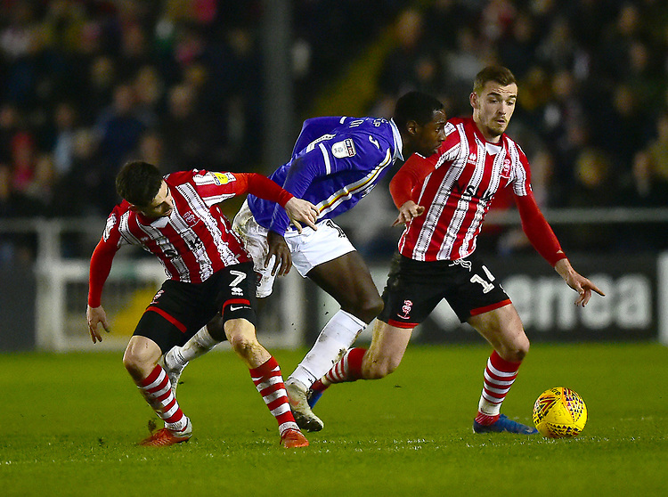 Lincoln City's Tom Pett, left, and Harry Toffolo vies for possession with  Exeter City's Jonathan Forte<br /> <br /> Photographer Andrew Vaughan/CameraSport<br /> <br /> The EFL Sky Bet League Two - Lincoln City v Exeter City - Tuesday 26th February 2019 - Sincil Bank - Lincoln<br /> <br /> World Copyright © 2019 CameraSport. All rights reserved. 43 Linden Ave. Countesthorpe. Leicester. England. LE8 5PG - Tel: +44 (0) 116 277 4147 - admin@camerasport.com - www.camerasport.com