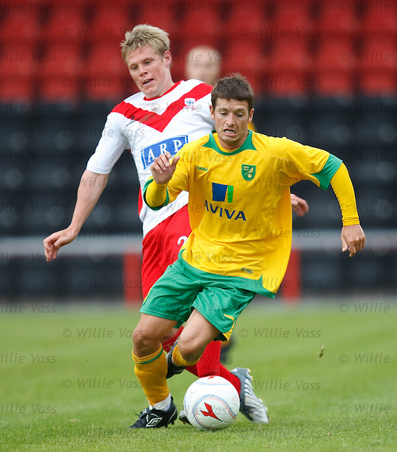 Wes Hoolahan fouled by Airdrie's Darren Smith