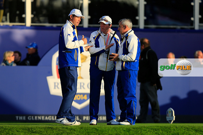 Padraig Harrington, Des Smyth and Paul McGinley on the 1st tee during the Saturday Fourball Matches of the Ryder Cup at Gleneagles Golf Club on Saturday 27th September 2014.<br /> Picture:  Thos Caffrey / www.golffile.ie