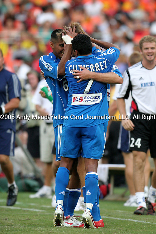 9 July 2005: Sasha Victorine (center) celebrates with Jose Burciaga, Jr. (6) and Diego Gutierrez (7) after scoring the game's only goal in the 77th minute. The Kansas City Wizards defeated DC United 1-0 at RFK Stadium in Washington, DC in a regular season Major League Soccer game. . .