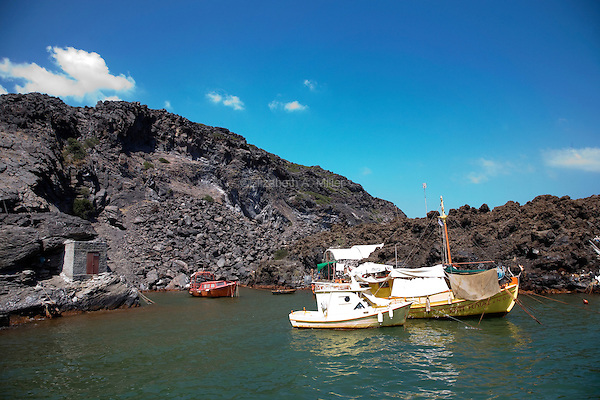 Boats that an elderly man lives on at the Hot Springs at the volcano Palea Kameni in Santorini, Greece on July 2, 2013.