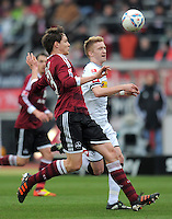 FUSSBALL   1. BUNDESLIGA  SAISON 2011/2012   24. Spieltag 1. FC Nuernberg - Borussia Moenchengladbach      04.03.2012 Philipp Wollscheid (li, 1 FC Nuernberg) gegen Marco Reus (Borussia Moenchengladbach)