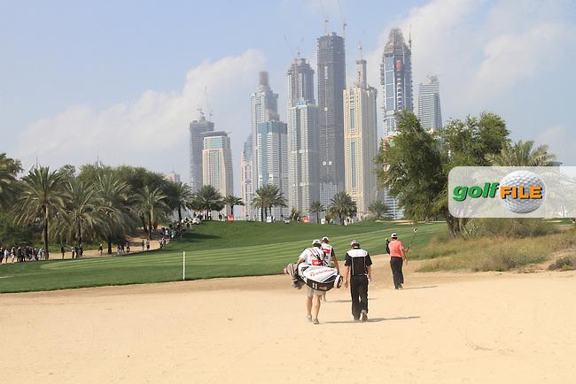 Rory McIlroy (NIR) and Edoardo Molinari (ITA) in action during the first round of the Omega Dubai Desert Classic 2011 on the Majlis Course, Emirates Golf Club, Dubai, UAE. 10/02/2011.Picture Fran Caffrey/www.golffile.ie.