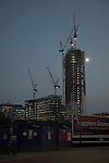 Bishopsgate and The Broadgate Tower under construction huge cranes from Shoreditch High Street, London East End, England, April 2007