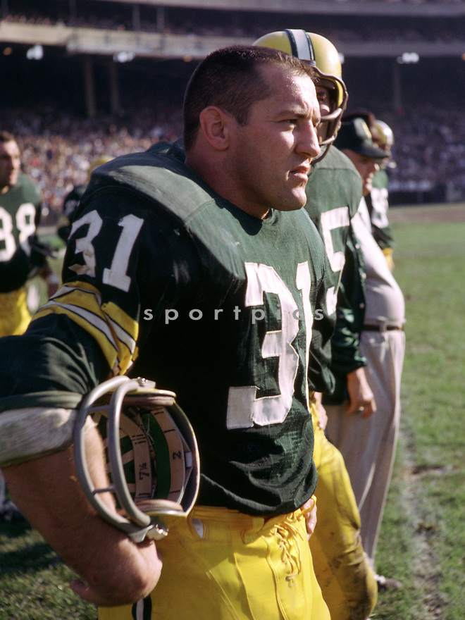 Green Bay Packers Jim Taylor (31) during the a game fro his 1964 season with the Green Bay Packers. Jim Taylor was a 5-time Pro Bowler, 1-time All-Pro team and was inducted to the Pro Football Hall of Fame in 1976.(SportPics)