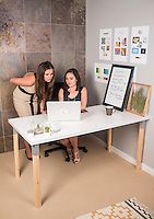 Owners of Cannabrand Olivia Mannix (cq) and Jennifer DeFalco (cq) in their Denver, Colorado, office, Friday, July 18, 2014. Cannabrand is a marketing company geared towards rem branding of companies in the marijuana industry.<br /> <br /> Photo by Matt Nager