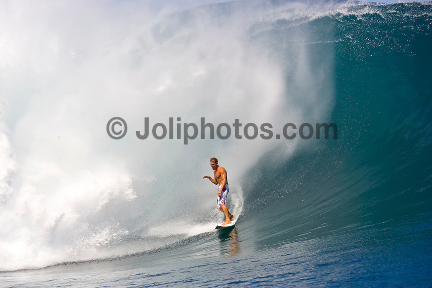 Andy Irons (HAW) surfing at Teahupoo, Tahiti during a two day swell session that included tow in and paddle in sessions featuring Top 45 surfers that became known as Maydayz. Photo: joliphotos.com