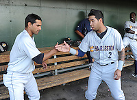 Infielder Ali Castillo (4), left, and Cito Culver (2) of the Charleston RiverDogs go through a pre game routine before a game against the Greenville Drive on June 2, 2012, at Fluor Field at the West End in Greenville, South Carolina. Greenville won, 10-4. (Tom Priddy/Four Seam Images)