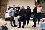 WATERBURY, CT-011518JS07--A resident shows Waterbury police something on her phone as they  investigate a shooting that occurred Tuesday at  the Mallview Condominium on Mark Lane in Waterbury. <br />   Jim Shannon Republican-American