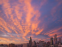 Sunset on the city of Chicago,creating pink clouds.