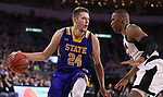 SIOUX FALLS, SD: MARCH 7: Mike Daum #24 of South Dakota State drives toward Tre'Shawn Thurman #15 of Omaha during the Men's Summit League Basketball Championship Game on March 7, 2017 at the Denny Sanford Premier Center in Sioux Falls, SD. (Photo by Dick Carlson/Inertia)