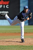 Asheville Tourists starting pitcher Chris Jensen #30 delivers a pitch during a game between the Delmarva Shorebirds and the Asheville Tourists at McCormick Field, Asheville, North Carolina April 7, 2012. The Tourists won game one of a double header  8-4  (Tony Farlow/Four Seam Images)..