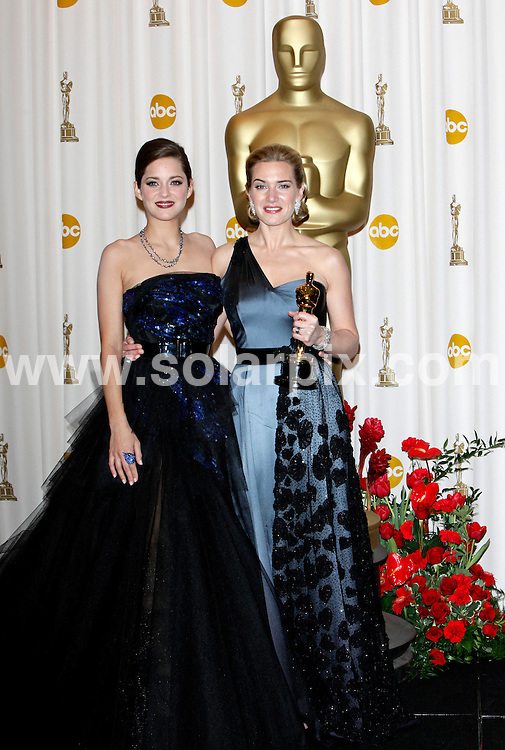 **ALL ROUND PICTURES FROM SOLARPIX.COM**.**SYNDICATION RIGHTS FOR UK AND SPAIN ONLY**.81st Annual Academy Awards, Press Room, The Kodak Theatre, Hollywood, CA, USA.This pic:  Marion Cotillard and Kate Winslet.JOB REF:    8539    CPR        DATE:  23.02.09.**MUST CREDIT SOLARPIX.COM OR DOUBLE FEE WILL BE CHARGED**.**ONLINE USAGE FEE  GBP 50.00 PER PICTURE - NOTIFICATION OF USAGE TO PHOTO @ SOLARPIX.COM**