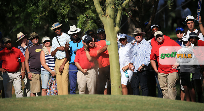 Charl Schwartzel (RSA) is joined by a hungry for action gallery as he plays his shot to the last from rough down the left-hand side during Round Three of the 2016 Tshwane Open, played at the Pretoria Country Club, Waterkloof, Pretoria, South Africa.  13/02/2016. Picture: Golffile | David Lloyd<br /> <br /> All photos usage must carry mandatory copyright credit (&copy; Golffile | David Lloyd)