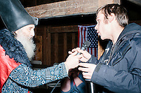 Ryan Fowler of the Stamp Stampede asks a questions to satirical presidential candidate Vermin Supreme at a campaign event at Ten Rod Farm in Rochester, New Hampshire. Supreme's platform advocates a pony-based economy, using zombies to solve the energy crisis, and other outlandish ideas. Supreme has been on the New Hampshire primary ballot in 2008 and 2012, though he began running for president in 1992. Vermin Supreme will be on the Democratic party ballot in the 2016 New Hampshire primary.