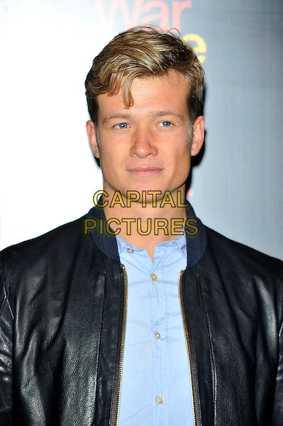 Ed Speleers.The 5th anniversary performance of 'War Horse' at The New London Theatre, Drury Lane, London, England..October 25th, 2012.headshot portrait blue shirt black leather jacket    .CAP/CJ.©Chris Joseph/Capital Pictures.