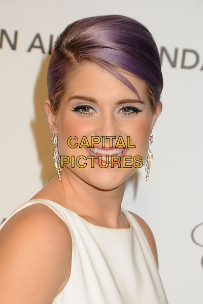 Kelly Osbourne.21st Annual Elton John Academy Awards Viewing Party held at West Hollywood Park, West Hollywood, California, USA..February 24th, 2013.oscars headshot portrait white sleeveless dyed purple hair pink lipstick green eyeshadow make-up beauty smiling  dangling diamond earrings .CAP/ADM/BP.©Byron Purvis/AdMedia/Capital Pictures.