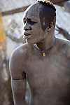 18 december 2010 - Juba, Southern Sudan - A wrestler of the Dinka tribe from Bor, Jonglei State applies dried cattle dung before the final of South Sudan's first commercial wrestling league between his tribe and the Mundari wrestlers from Central Equatoria State at Juba Stadium. The matches attracted large numbers of spectators who sang, played drums and danced in support of their favorite wrestlers. The match organizers hoped that the traditional sport would bring together South Sudan's many different tribes. Photo credit: Benedicte Desrus
