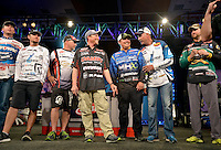 NWA Democrat-Gazette/BEN GOFF -- 04/25/15 Andy Morgan (second from right, going left), FLW Pro from Dayton, Tenn., John Cox, FLW pro from Debary, Fla., and Bryan Thrift, FLW pro from Shelby, N.C., share a laugh as the final ten competitors advancing into day four take the stage after weigh-in on day three of the Walmart FLW Tour at Beaver Lake on Saturday Apr. 25, 2015 at the John Q. Hammons Center in Rogers. Morgan maintained his lead with a three-day total weight of 39 lbs. 2 oz.