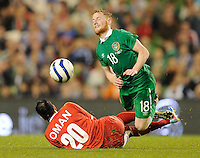 3rd September 2014; International Friendly, Republic of Ireland v Oman, Aviva Stadium, Dublin. <br /> Republic of Ireland's Stephen Quinn is tackled by Mohammed Al Sivabi of Oman<br /> Picture credit: Tommy Grealy/actionshots.ie.