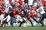 Nyheim Hines (7) of the North Carolina State Wolfpack is tackled by Taylor Stallworth (90) of the South Carolina Gamecocks during first half action in the Belk College Kickoff at Bank of America Stadium on September 2, 2017 in Charlotte, North Carolina.  The Gamecocks defeated the Wolfpack 35-28.  (Brian Westerholt/Sports On Film)