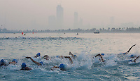 13 MAR 2010 - ABU DHABI, UAE - The elites womens wave gets under way during the Abu Dhabi International Triathlon .(PHOTO (C) NIGEL FARROW)