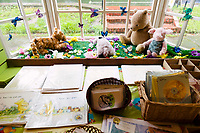 Winnie the Pooh branded goods, in Pooh Corner, a shop and teashop dedicated to the A.A. Milne Winnie the Pooh stories. Ashdown Forest, Sussex, UK, May 20, 2017. Picturesque Ashdown Forest stretches across the countries of Surrey, Sussex and Kent, and is the largest open access space in the South East of England. It is famous as the geographical inspiration for the Winnie the Pooh stories and is popular with fans of the characters.